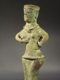 Near Eastern bronze fertility goddess balsamarium.