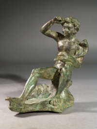 Hellenistic bronze Satyr seated on a rock