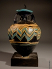 Greek core-formed blue glass amphoriskos with turquoise and yellow glass trailing.