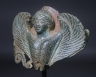 Classical Greek bronze siren. (Hydria handle appliqu???�).
