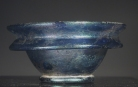 Early Roman blue glass small cosmetic bowl.