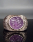 Roman silver ring with amethyst intaglio.