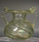 Roman clear glass jar with two handles.