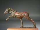 Hellenistic bronze galloping horse.