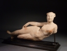 Parthian alabaster reclining figurine of a woman, possibly Aphrodite.