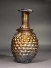 "Roman molded golden amber glass ""Grapes"" flask."