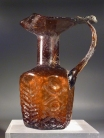 Early Byzantine molded honey-amber glass hexagonal flask.