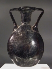 Late Roman dark amber - black glass lentoid flask.