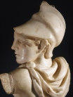 Roman marble of a Greek warrior, a fragmentary sarcophagus relief.