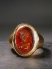 Roman athlete bust Carnelian intaglio. Set in modern 18K gold ring.